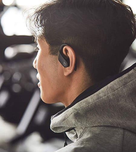 Powerbeats Pro wireless headphones on someone's ear